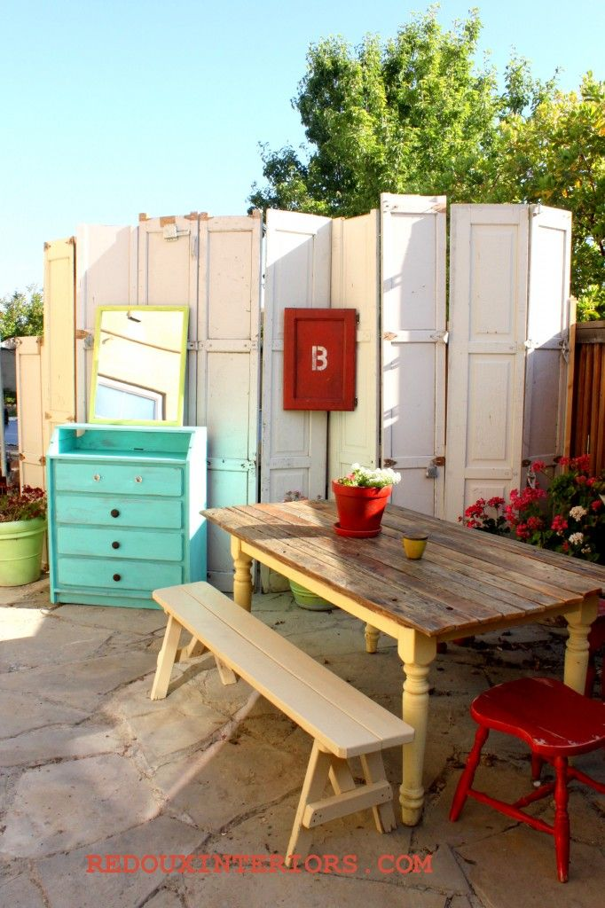 Upcycled Outdoor Patio. Outdoor wall made from Garage Door panels, upcycled table, and more. CeCe Caldwels Santa Fe Turquoise on Changing Table turned Buffet REDOUXINTERIORS.COM FACEBOOK:REDOUX