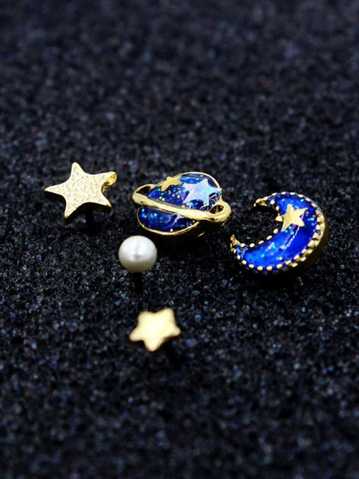 Sun, moon and stars, plus planet Saturn hipster space galaxy trendy stud earrings. This set of 5 stud earrings includes dainty gold stars, a pearl stud, and a blue, glitter and gold moon and planet. US seller.