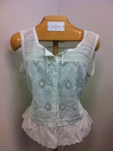 cotton broderie anglaise blouse with embroidery overlay shoulders, hidden buttons and a ruffle hem - by Ralf Lauren