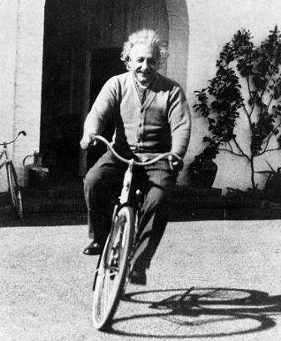 Albert Einstein on a bicycle