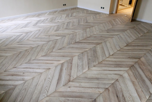 Chevron Pattern Flooring in Either Reclaimed Wood or Grey Limestone