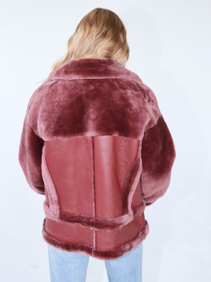 Made out of super soft lambskin, this bomber jacket will instantly update your look. Featuring a lambskin body with fur sleeves. This style comes with circular zip pullers. Model is size UK 8, height 165cm and wears a S in this shot but would normally take a size XS.​​​This style is available to pre-order now. Orders take aprox 21 days to receive. Please contact info@ducie.co.uk for more information or help on sizing.