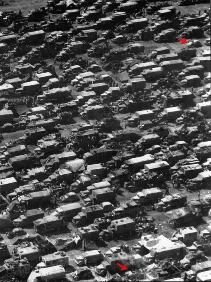 Photograph of German vehicles attempting to escape from the closing noose of the Allied armies. They are attempting to cross one of the remaining bridges outside of Aachen in 1945. This photo was taken by an American recon plane.