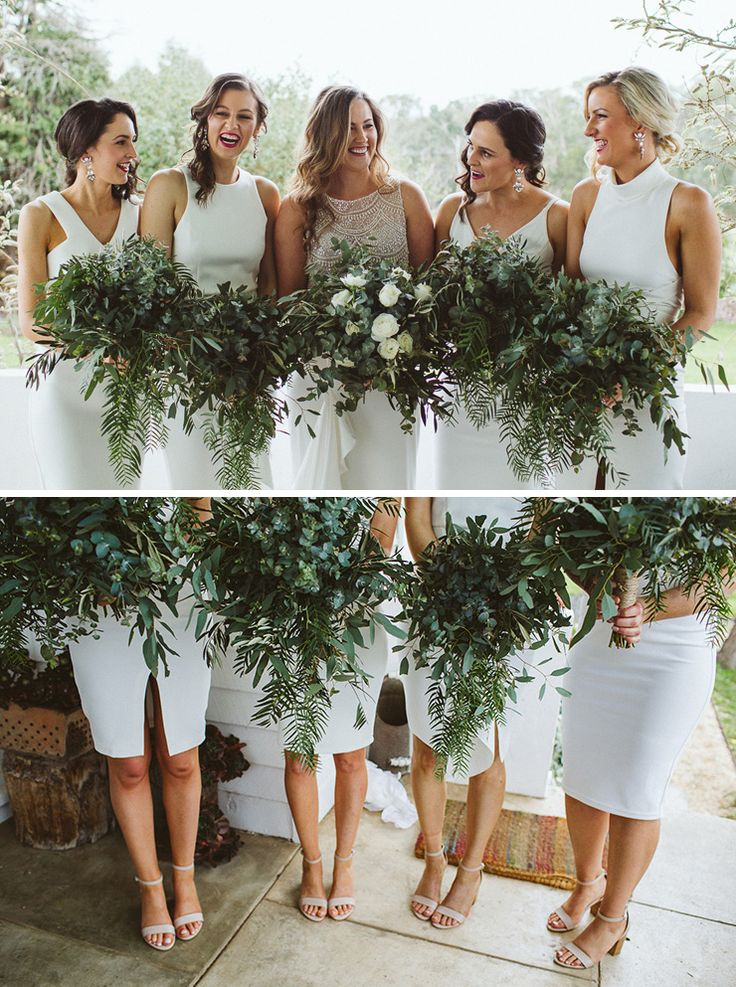 Modern bridesmaids wearing sleek white cocktail dresses paired with statement earrings and lush greenery bouquets | Sarah Godenzi Photography