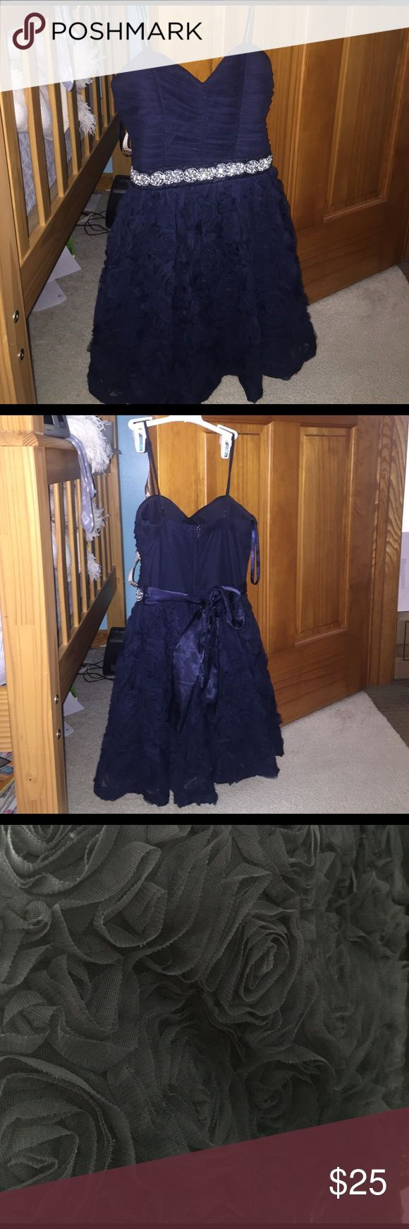 Navy blue formal dress Only worn once for homecoming! Short navy blue dress with a floral textured skirt (as shown in 3rd picture). Padded top ! Trixxi Dresses Prom