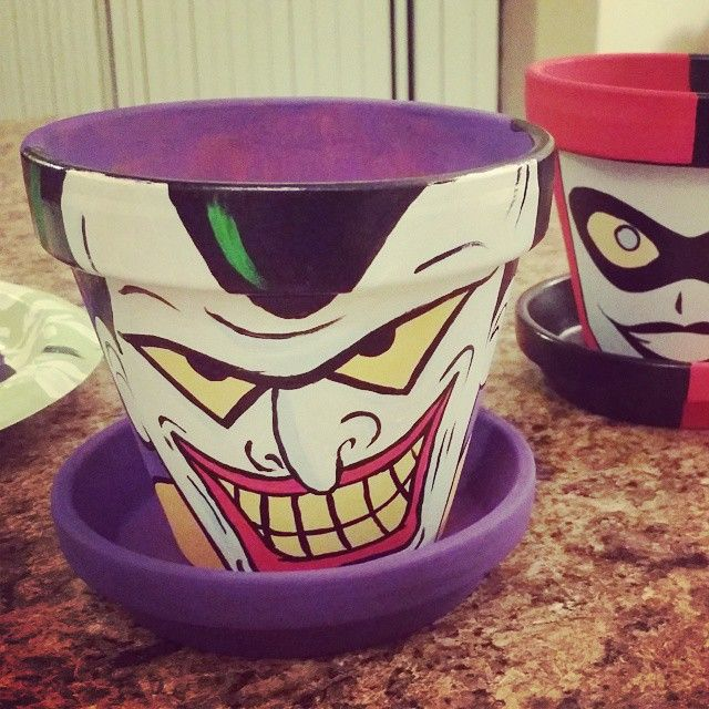 The Joker and his lady :)) Hop on my twitter @tifftoxic or my Facebook Like page art.by.tiff for the link to get your own custom made pot! #batman #flowerpot #pot #diy #painting #thejoker #joker...