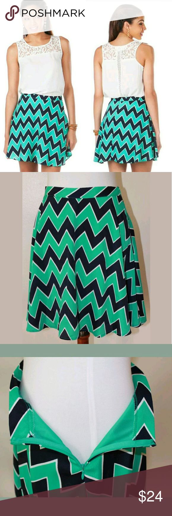 Francesca's Medium Navy Mint North Chevron Skirt Chevron is back with the North Shore Chevron Skirt! Navy and mint are the perfect color combo in this chevron skater skirt. Finished with a side seam zipper.   Measurements (approximately) - 18? length  - 27? waist  Shell and lining: 100% Polyester  Made in the U.S.A.  Smoke free home. Buttons Skirts Midi