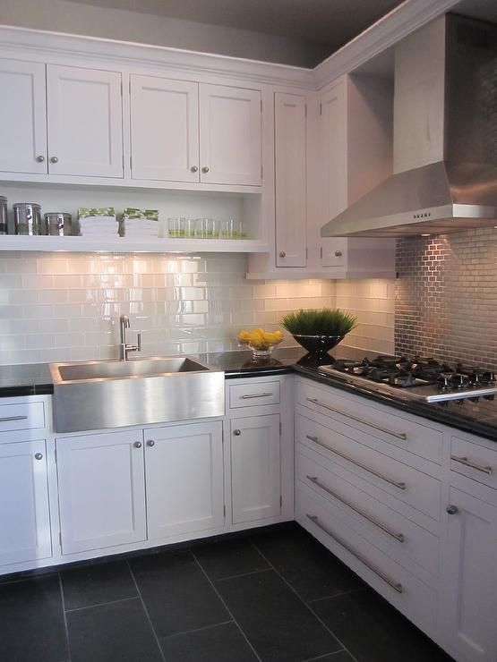 kitchen with white cabinets white glass subway tile and stainless steel accent tile - Kitchen Floor Tile Design Ideas