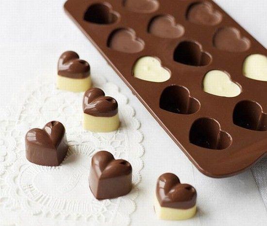 Chocolates... yum yum yum ... Ice maker... coat with pam spray prior to filling with chocolate