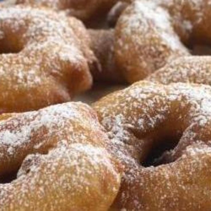 MMmmm MMmmmm Good!  Apple ring fritters!  They look like doughnuts but what a surprise!  Deep fried apple rings!!