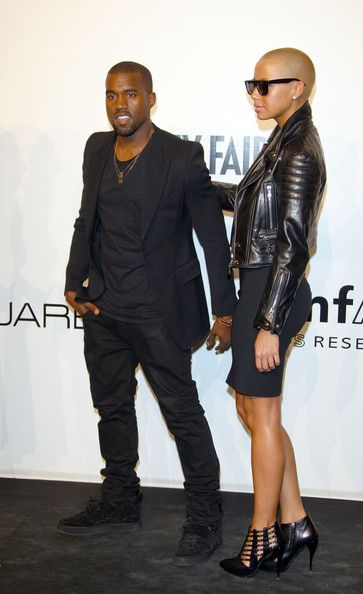 Kanye West and Amber Rose Photos - Kanye West and Amber Rose attend amfAR Milano 2009 red carpet, the Inaugural Milan Fashion Week event at La Permanente on September 28, 2009 in Milan, Italy. - amfAR's Inaugural Milan Fashion Week Event - Arrivals