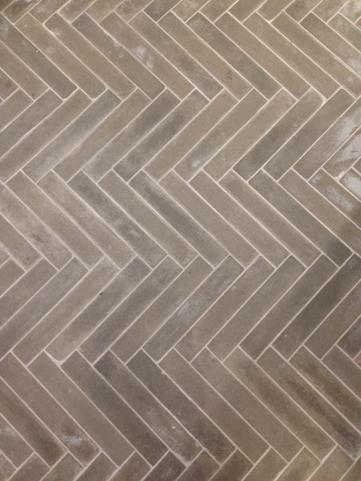 grey herringbone tile...