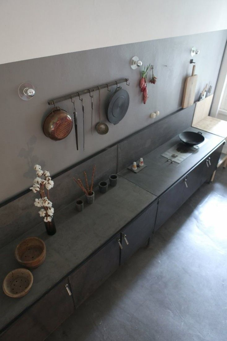 remove upper cabinets paint backsplash to height of metal stove backsplash in gray.  Pietro Russo in Milan | Remodelista