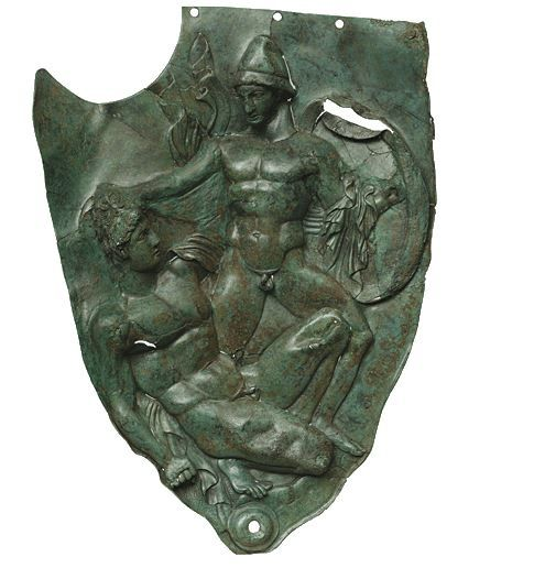 Calchidian helmet cheekpiece, 4th century B.C. Showing warriors engaged in a battle, from the sanctuary of Zeus at Dodona