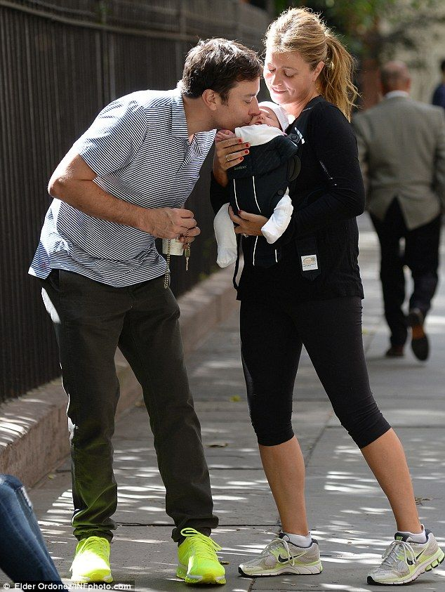 As if we couldn't love Jimmy Fallon more - here he is with his little family giving his daughter a sweet kiss.  L*OV*E
