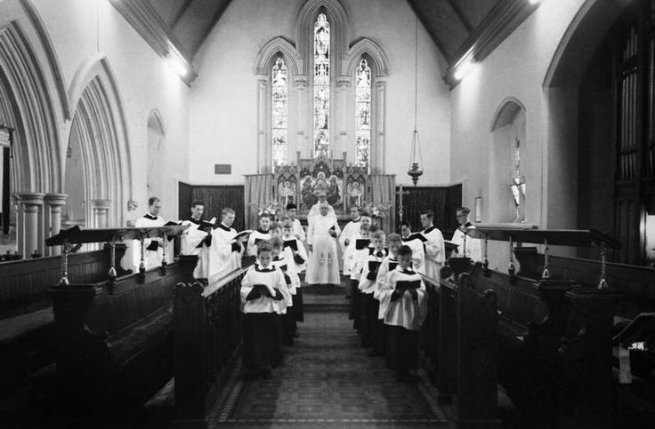 MP 11130. The choir boys and ministers in St George's Church, Glenferrie Road, Malvern, 1953