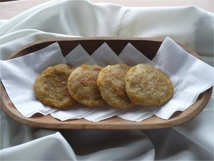 Milcao. This dish is made by mixing warm mashed potatoes and grated raw potato, which is squeezed to remove the starch. Then form small balls that are filled with pork rinds (or sausage or cheese) and fried.