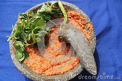 Dough of sauce on mortar stone.