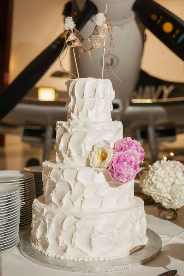 Rough Icing Wedding Cake With Just Married Topper
