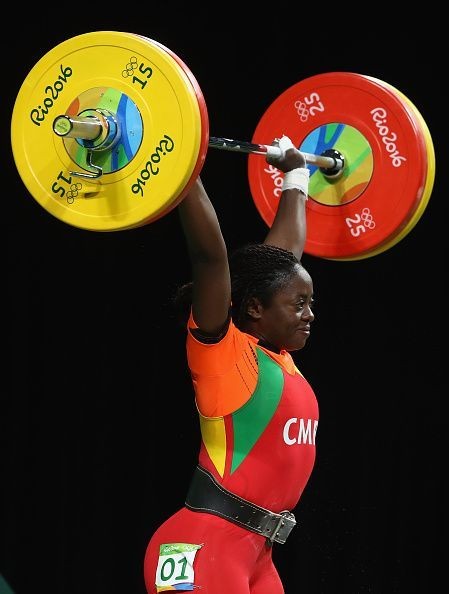 #RIO2016 Arcangeline Fouodji Sonkbou of Cameroon lifts during the Women's 69kg Group B weightlifting contest on Day 5 of the Rio 2016 Olympic Games at...