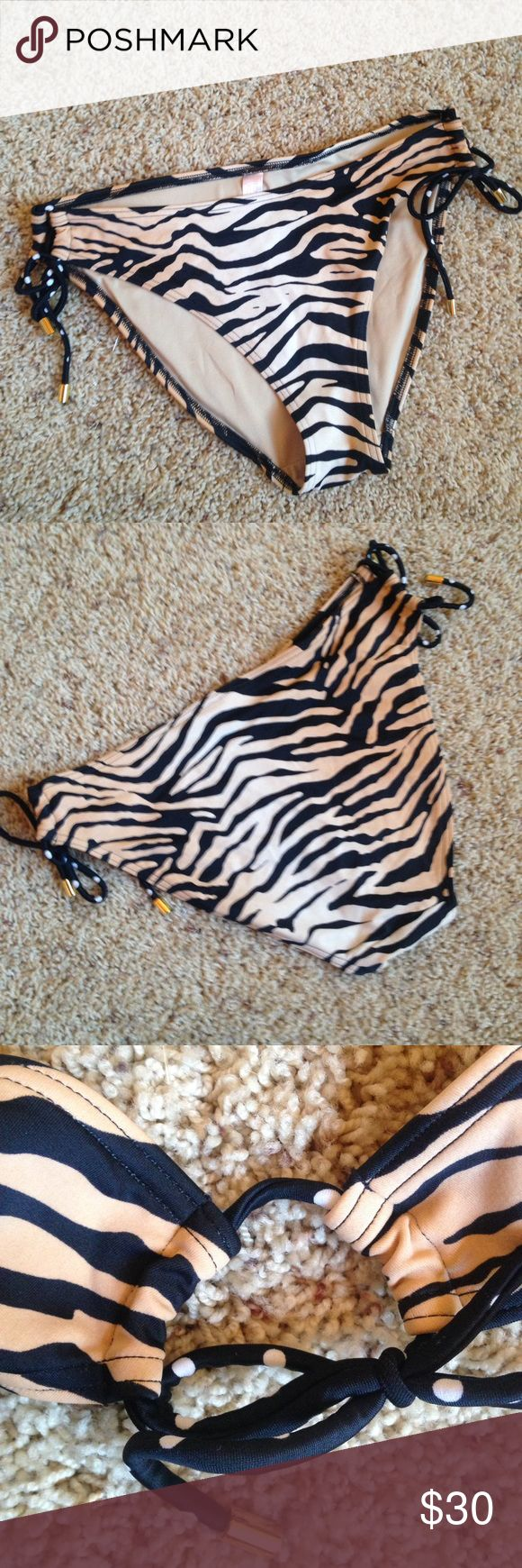 Victoria's Secret Animal Print Bikini Bottom, M Great condition Bikini Bottom by Victoria's Secret. Ties on the size with black and white polka dot ties. Size Medium. Slight markings left by the hygienic lining (pictured). Matching Top also listed. Victoria's Secret Swim Bikinis