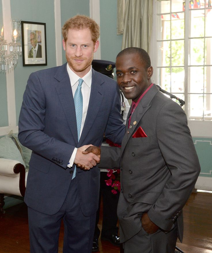 Prince Harry Photos Photos - Prince Harry gives an award to Glen Joseph, during the investiture at a Charity showcase at Government House on the second day of an official visit to the Caribbean on November 21, 2016 in Antigua, Antigua and Barbuda. Prince Harry's visit to The Caribbean marks the 35th Anniversary of Independence in Antigua and Barbuda and the 50th Anniversary of Independence in Barbados and Guyana. - Prince Harry Visits The Caribbean - Day 2