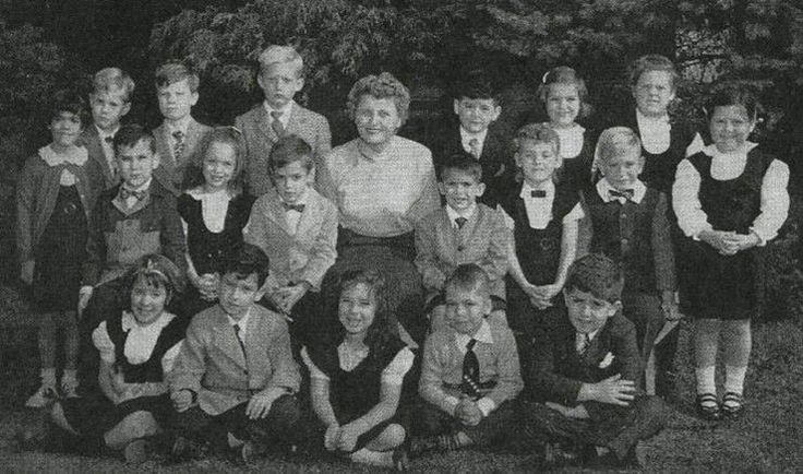 Trump stands next to his school teacher, back row, fourth from the left, with his first grade class at Kew-Forest School. (From the Kew-Forest School yearbook)