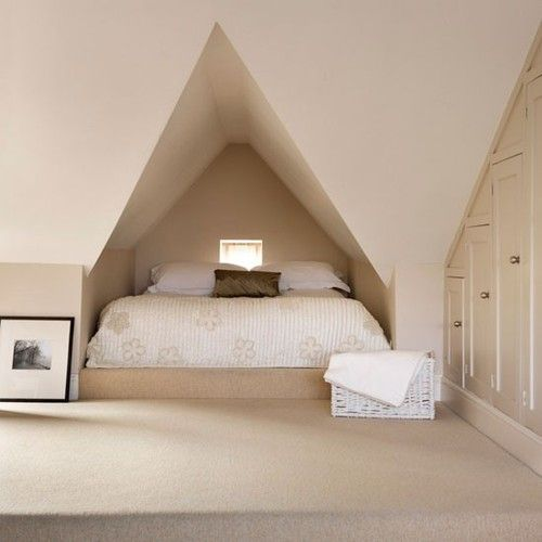 Neutral attic bedroom: This awkward alcove has been used to create a structural canopy for a double bed. The neutral colour scheme keeps the room looking light and airy.