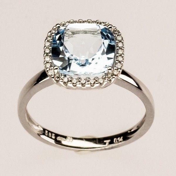 973R Witgouden ring met blauwe topaas en diamant