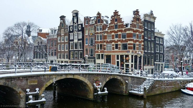 This is one of the most-photographed spots in Amsterdam — the corner of Brouwersgracht and Prinsengracht. At the corner is Café Papeneiland...