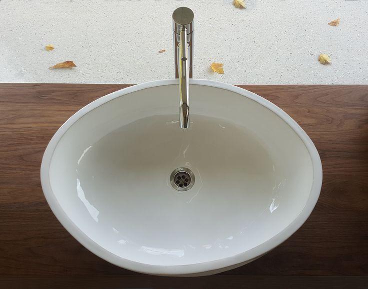 Oversized handmade ceramic basin – 65 cm across – mounted on custom walnut bathroom cabinet. #handmade #sink #basin #ceramics