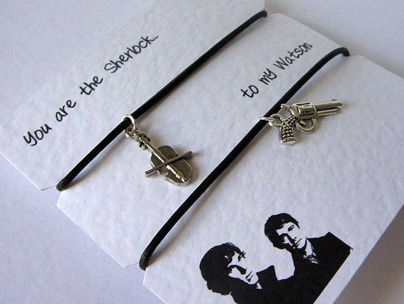 A Pair of Sherlock & John Watson Brown Leather cord friendship bracelets with silver plated charms mounted on 300gsm quote greeting card