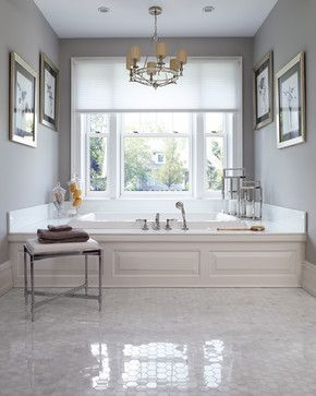 The gentle light diffusion of Duette® honeycomb shades provide an ethereal elegance to this gray and white bathroom decor. ♦ Hunter Douglas window treatments