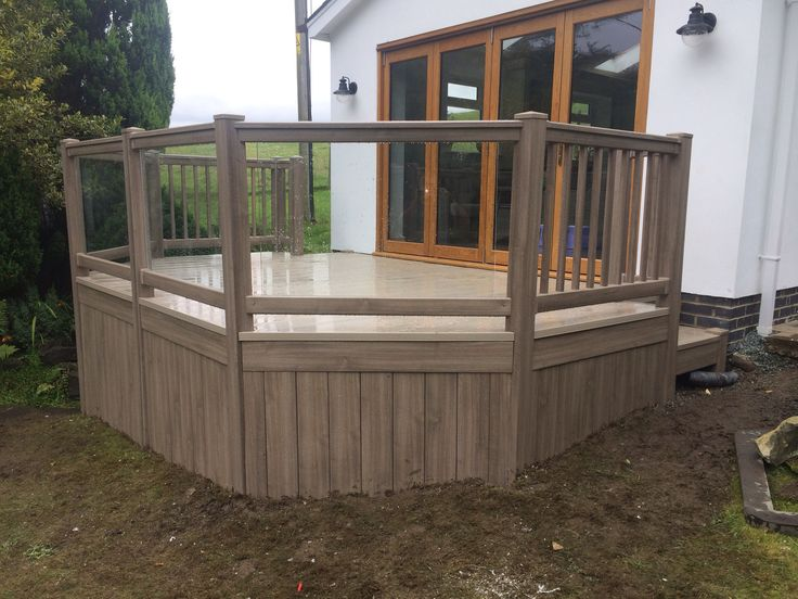 Fensys UPVC plastic garden decking with renolit foiled hand rail and toughened clear glass panels