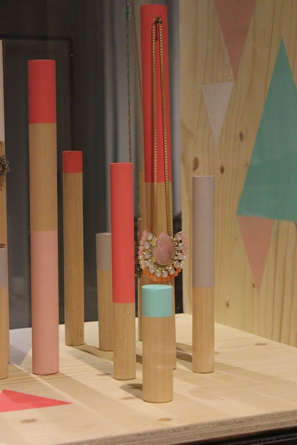 Fabric orders come wrapped around sturdy cardboard tubes. Upholster or paint them for a striking store display.