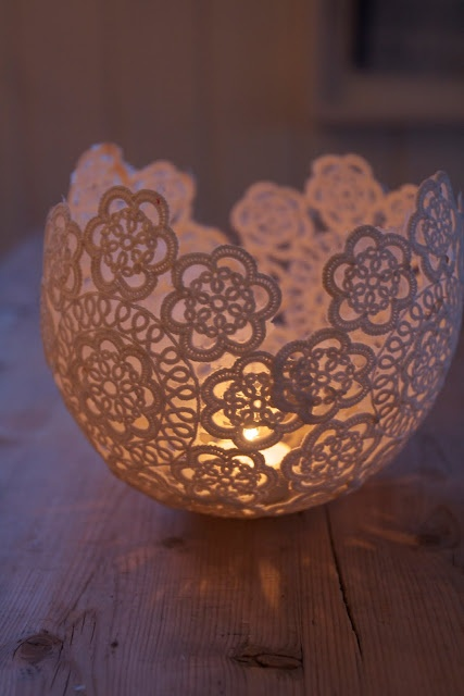 Soak lace doiles in glue, arrange on a blown up balloon, brush on 1 more coat of glue & let dry for at least 24 hrs. Pop balloon, carefully peel away & voila! You have a lace bowl!