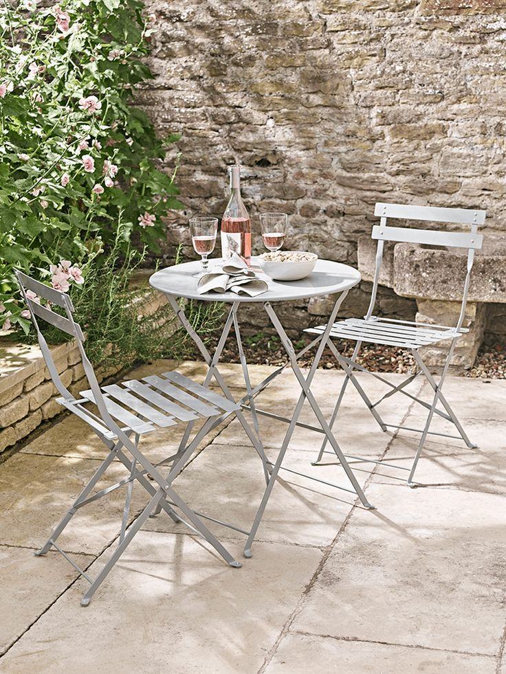 Crafted from powder coated steel, our elegant Bistro set is a chic addition to any garden or balcony. The soft grey colour tone gives a sophisticated look, while the practical design allows you to fold both the table and chairs away, so they can be stored when not in use.