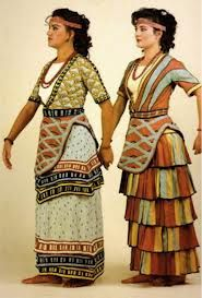 Minoan dresses. The flounces are what make the skirts, and the tunics are unique, appearing to be a fitted under layer with an open-chested tunic over it.