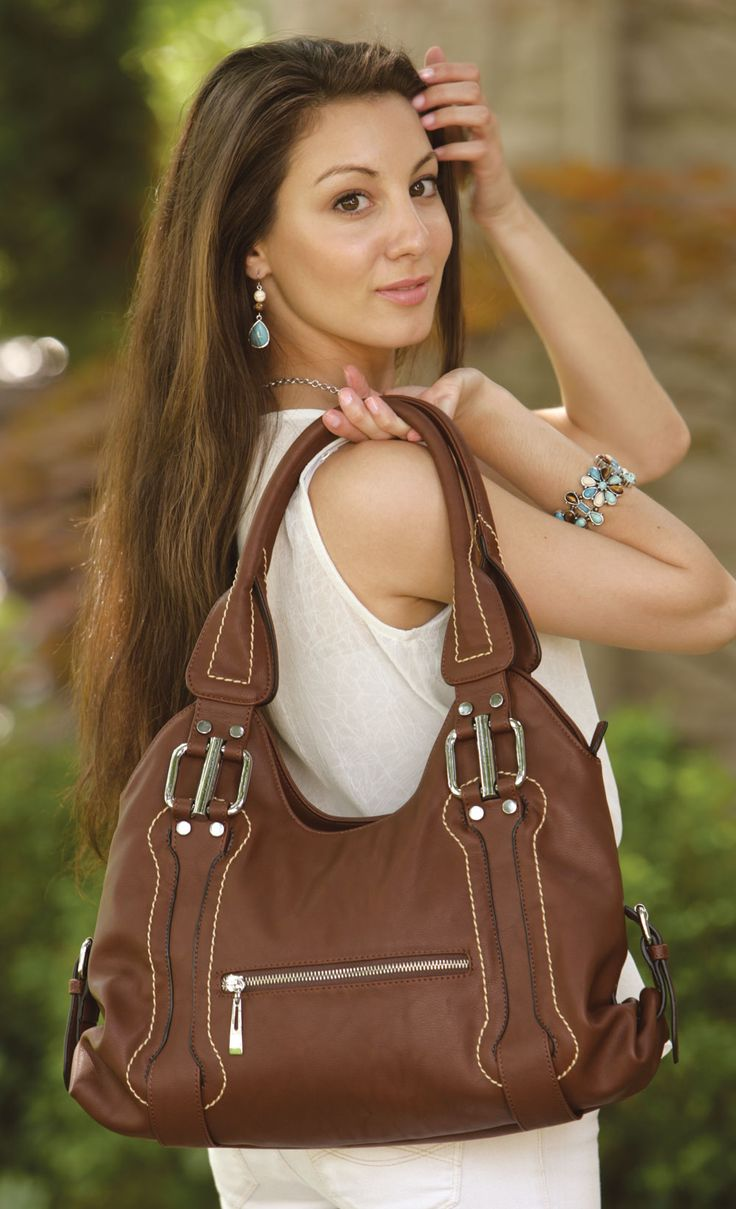 Sierra Handbag - This stylish handbag is designed in a rich shade of brown and features silver metal accessories, a zippered top closure, and two zippered outer pockets, as well as convenient open and zippered inner pockets. Find out more at www.EverydayStyle.com