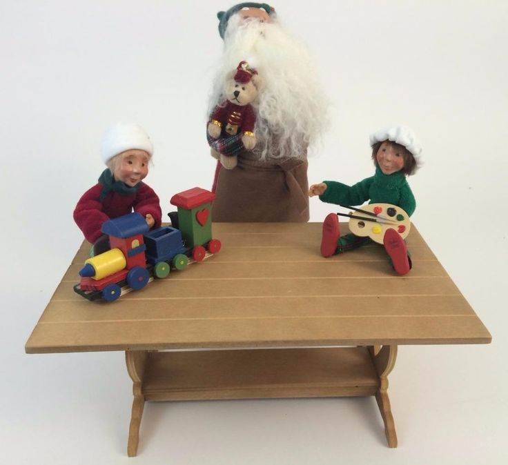Fun and playful addition to your display of #ByersChoice Carolers. Christmas #Santa Toy Maker Caroler has his wooden workshop bench and 2 #Kindles helping himm make and paint the toys!  Retired.