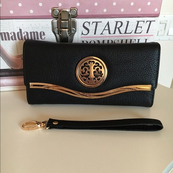 Black wallet ❤️❤️❤️ Fashion black wallet with enough to room for credit cards, also comes with strap to use as wristlet. Bags Wallets