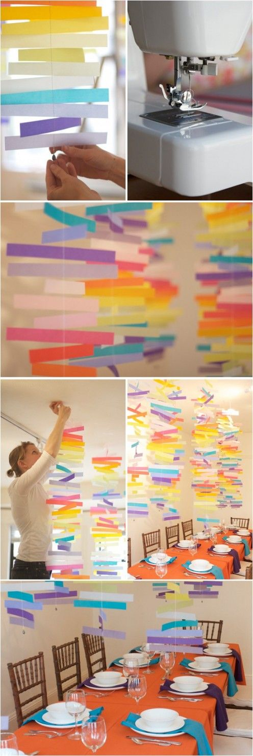 These rainbow mobiles are sure to make a statement. Sew strips of velum paper together, attach a fishing weight to one end to keep them from moving to much and hang from the celling with artist tape. (Click the link for the full how to.)