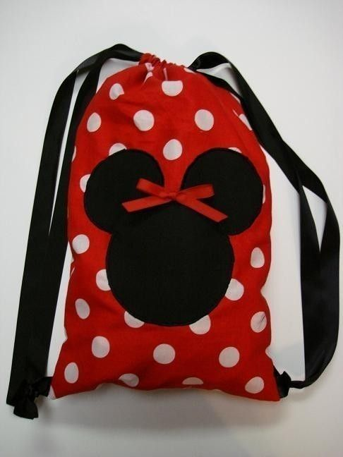Minnie Mouse drawstring backpack <3. apparently someone copied my original Idead. I made one almost like this for our trip last year. Theymust of saw it when I was down there, liked it so much they had to make one too!