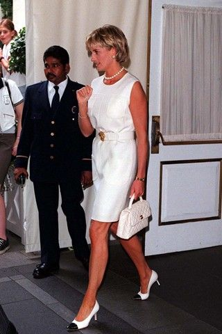 JUNE 1997 – Wearing a white dress and classic white Chanel accessories, Diana…