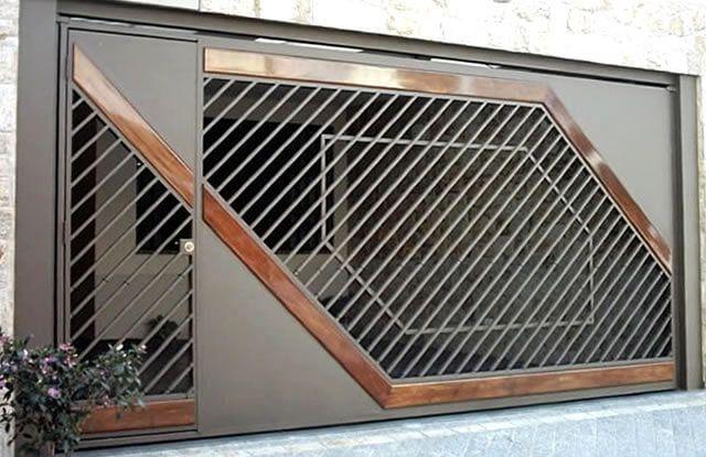 Portão Tubular Madeira EP-212 com preenchimento de metalon de aço carbono 100% galvanizado em diversos perfis. Pode conter detalhes em tubos de aço, chapa ou madeira.