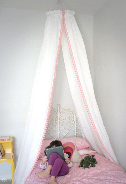 small shop: DIY bed tent pom pom canopy, John Robshaw bedding, Jonathan Adler pillow, vintage wicker headboard