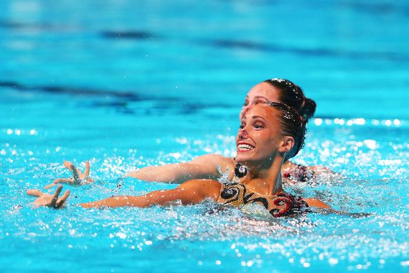 Olivia Federici and Jenna Randall of Great Britain compete in the Synchronized Swimming Duet Technical final on day two of the 15th FINA World Championships at Palau Sant Jordi on July 21, 2013 in Barcelona, Spain.