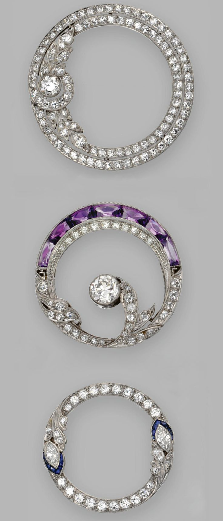 GROUP OF THREE COLORED STONE AND DIAMOND BROOCHES, 1930.