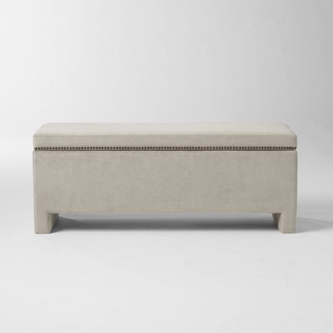 I don't love the way this looks, but I think the best idea for a coffee table would be both bench and storage. I'd also add wheels: Westelm, Idea, Coffee Table, Ottoman