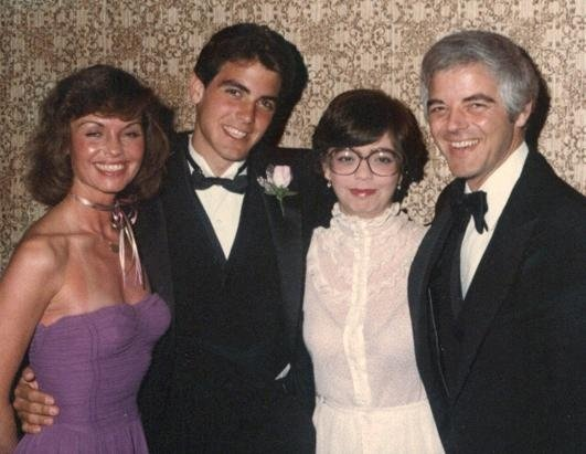 Clooney smiles at the Miss Indiana pageant, which father Nick Clooney hosted for many years. His mother, Nina, is pictured far left in the strapless lavender gown, with Clooney, sister Ada and dad Nick.